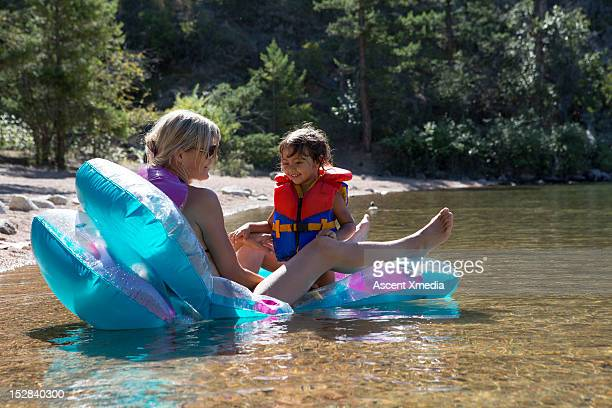 Mother and daughter enjoy lake shallows by beach