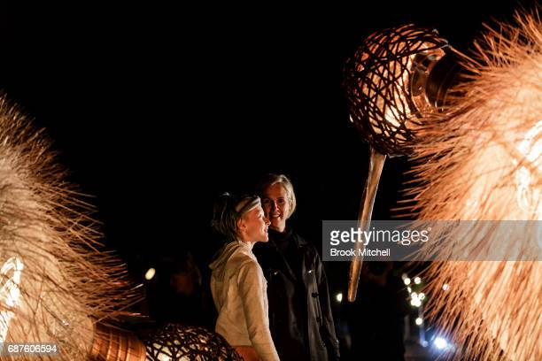 A mother and daughter enjoy the Birds of Lumos installation ahead of Vivid Sydney at The Royal Botanic Gardens on May 24 2017 in Sydney Australia...