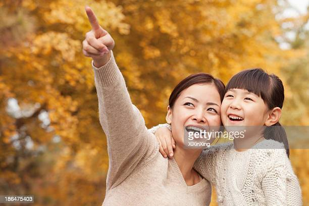Mother and Daughter Enjoying a Park in Autumn