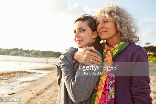 Mother and daughter enjoying beach