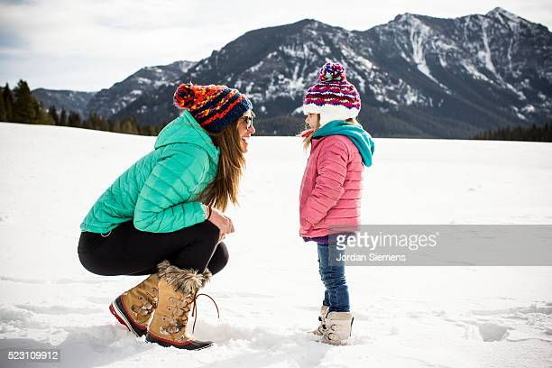 Mother and daughter (4-5) enjoying day out in winter, Bozeman, Gallatin County, Montana, USA