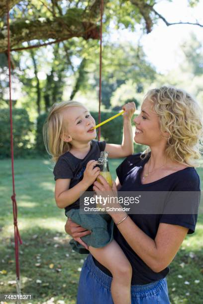 Mother and daughter enjoying garden