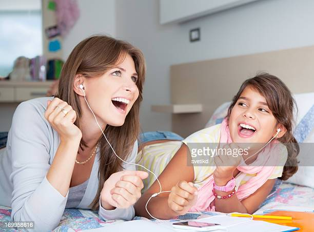Mother and daughter enjoying music.