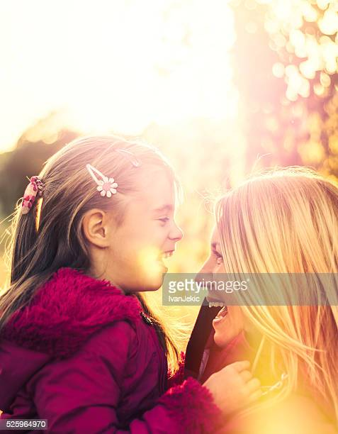 Mother and daughter enjoying themselves at sunset