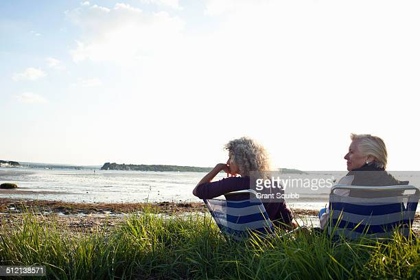 Mother and daughter enjoying view on beach