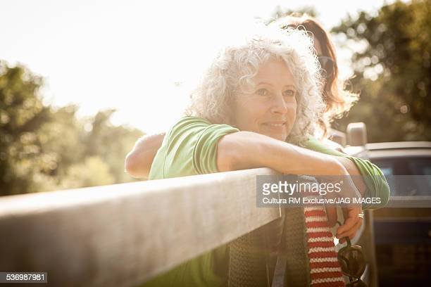 Mother and daughter enjoying view over fence