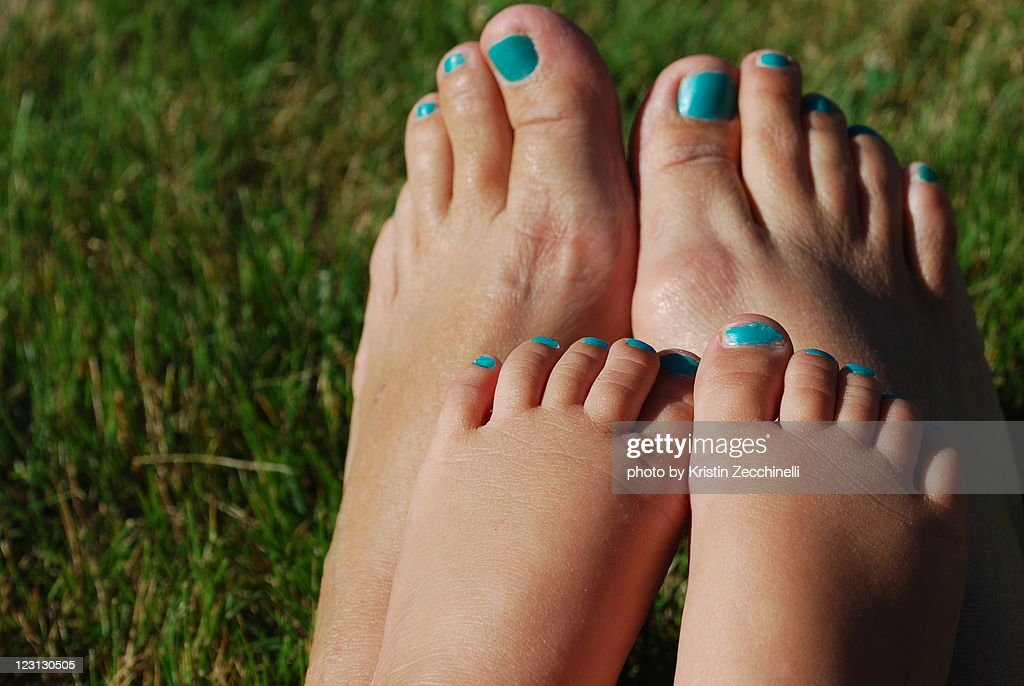Mother and daughter feet : Stock Photo