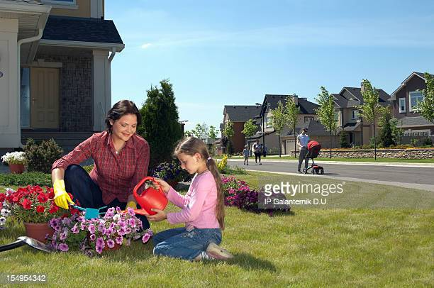 Mother and daughter gardening on
