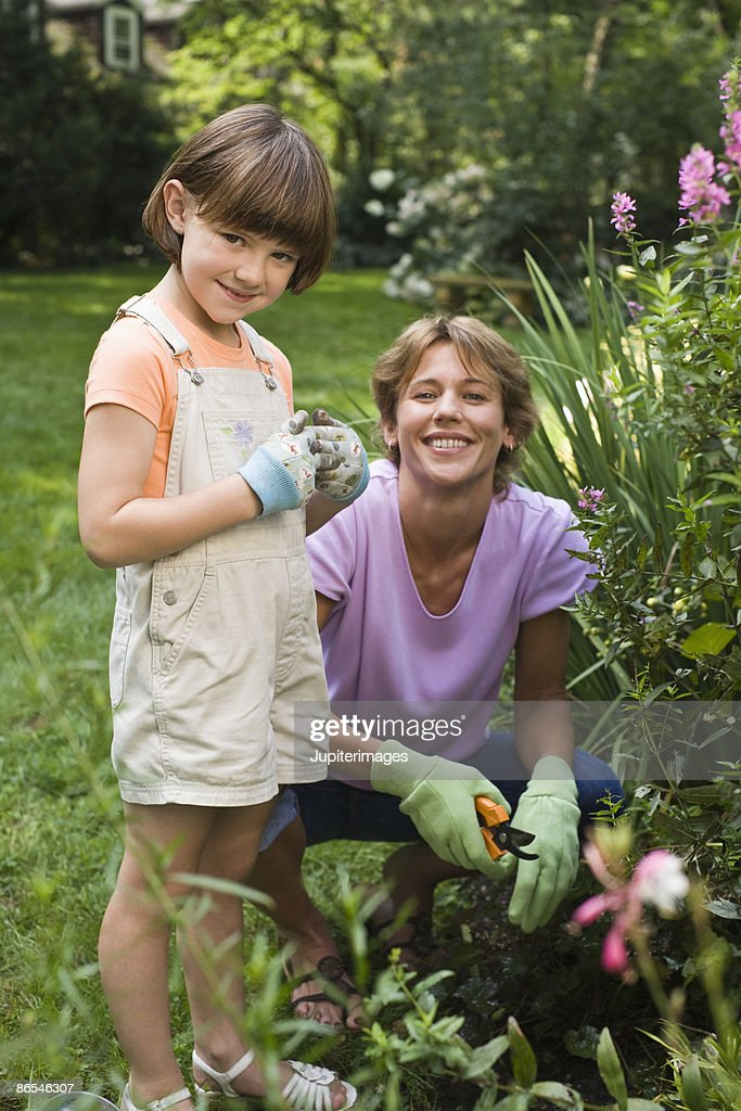 Mother and daughter gardening : Stock Photo