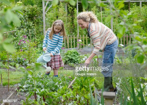 Mother and daughter gardening together. : Stock Photo