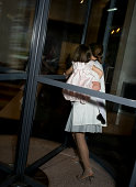 Mother and daughter going through revolving door