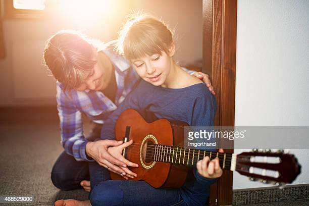 Mother and daughter guitar lesson