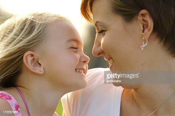 Mother and daughter happily facing each other