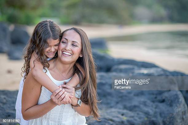 Mother and Daughter Happily Playing on the Beach Together