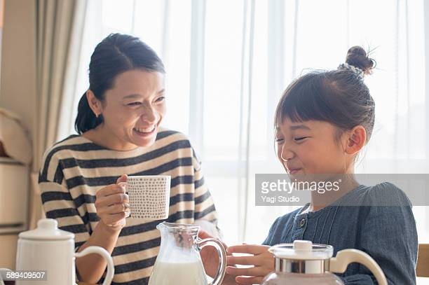 Mother and daughter have a coffee break