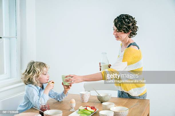 Mother and daughter have breakfast together