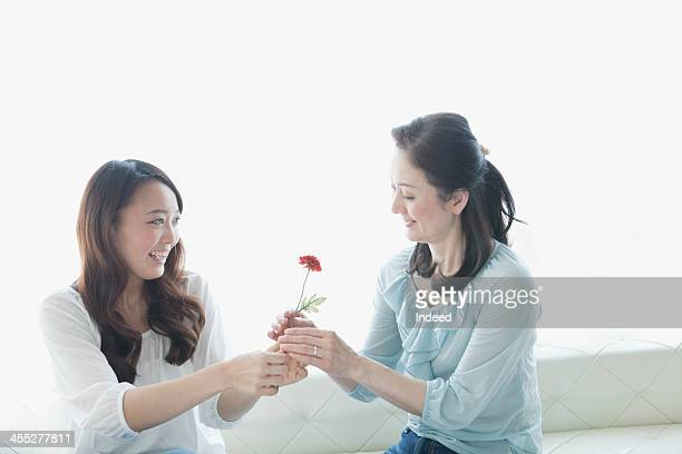 Mother and daughter having a flower