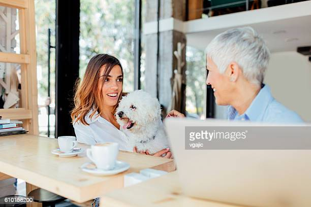Mother and Daughter Having Coffee In Local Cafe