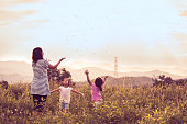 Mother and daughter having fun and playing together in the cornfield in vintage color tone