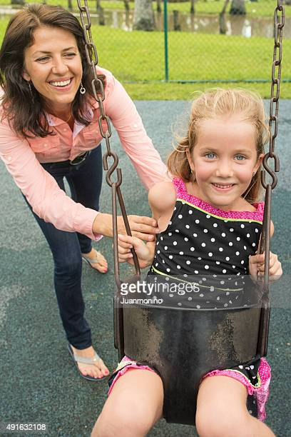Mother and daughter having fun in a park
