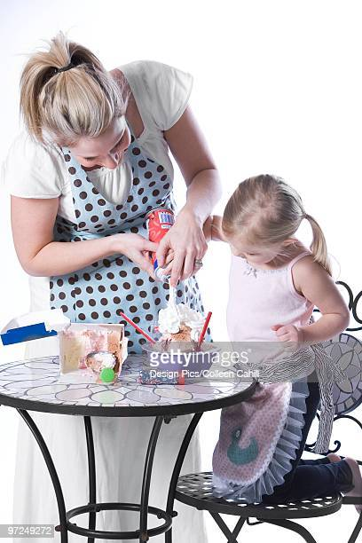 Mother and daughter having ice cream
