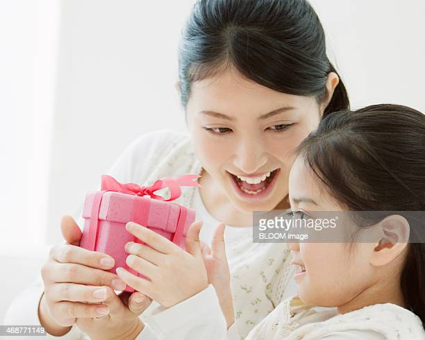 Mother And Daughter Holding A Gift