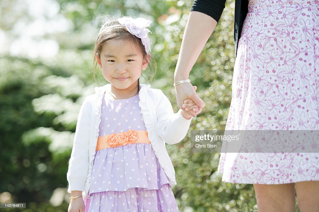 Mother and Daughter holding hands : Stock Photo