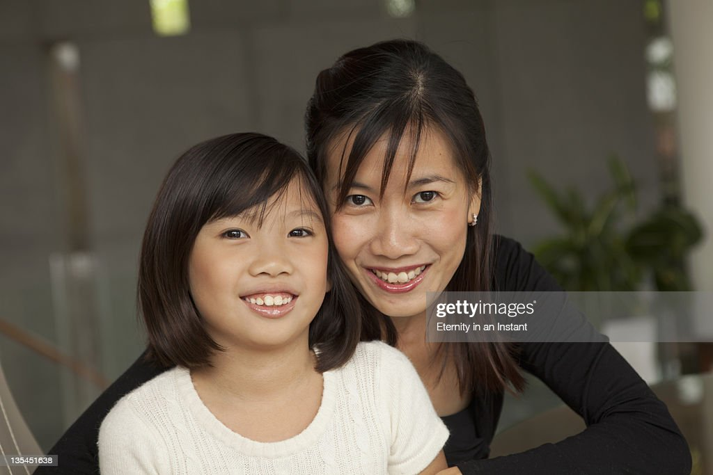 Mother and daughter hugging and smiling : Stock Photo