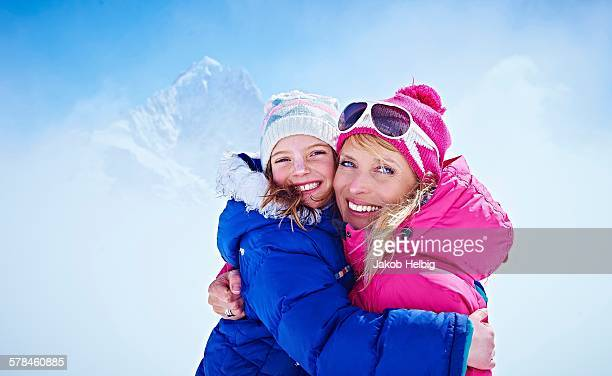 Mother and daughter hugging, Chamonix, France