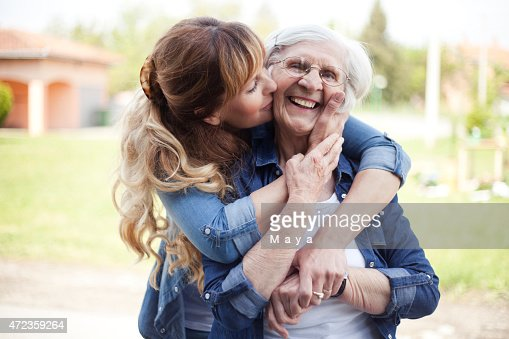 A mother and daughter hugging each other