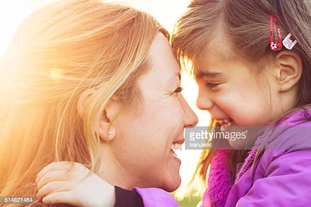 Mother and daughter hugging headshot