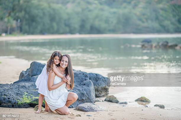 Mother and Daughter Hugging on the Beach