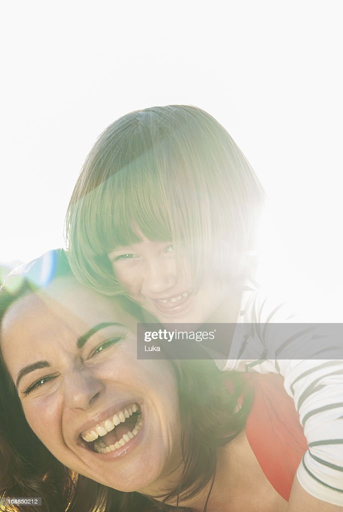 Mother and daughter hugging outdoors : Stock Photo