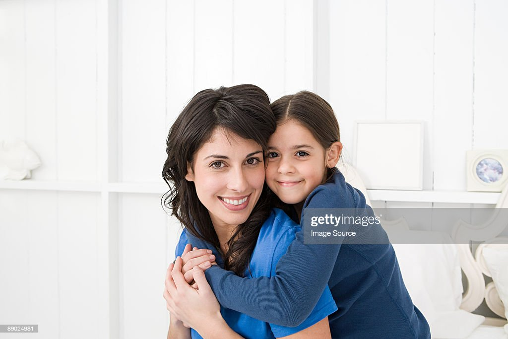 Mother and daughter hugging : Stock Photo