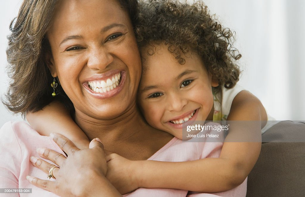 Mother and daughter (4-6) hugging, portrait : Stock Photo