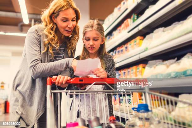 Mother and Daughter In A Supermarket