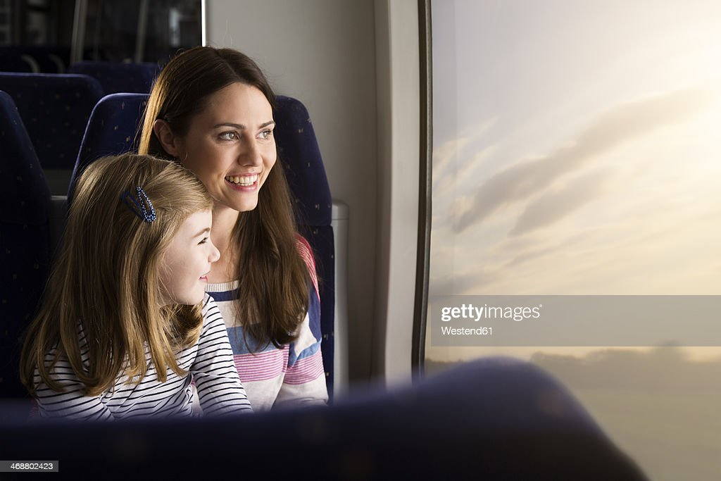 Mother and daughter in a train : Stock-Foto