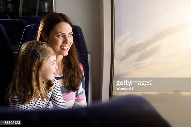 Mother and daughter in a train