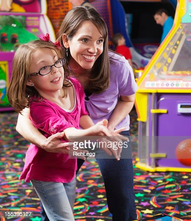 Mother and Daughter in an Amusement Arcade