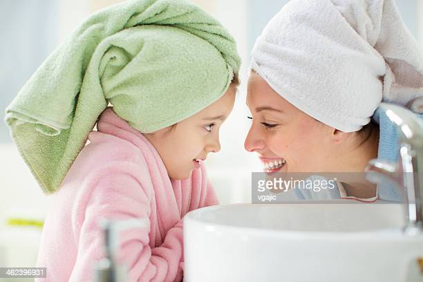 Mother and daughter in bathroom.