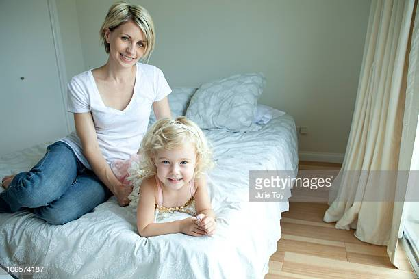Mother and daughter in bedroom