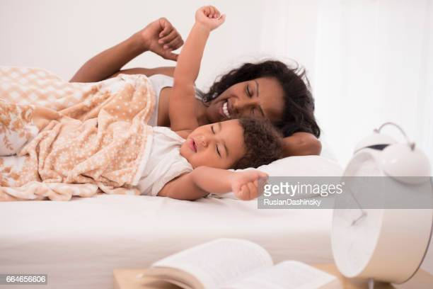 Mother and daughter in bedtime.
