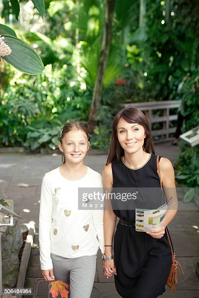 Mother and daughter in botanical garden