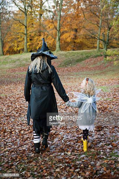 Mother and daughter in costumes