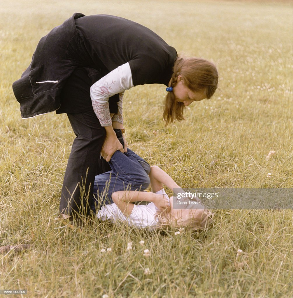 Mother and Daughter in Field : Stock Photo