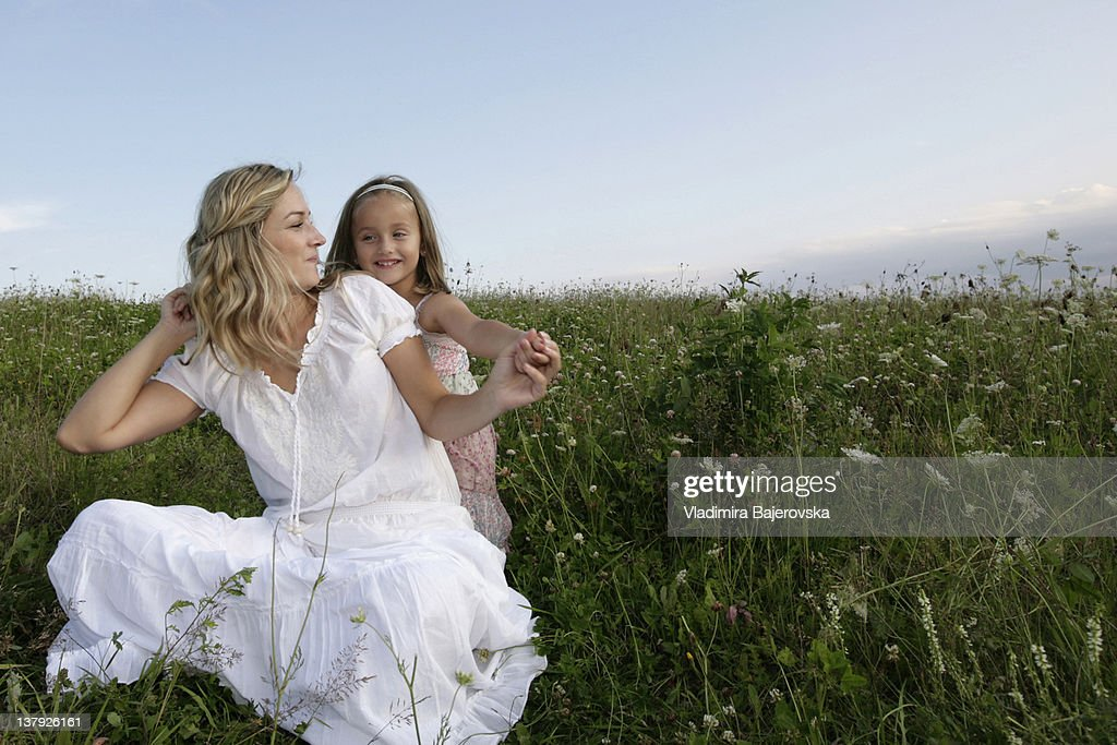 Mother and daughter in field, Western Cape Province, South Africa : Stock Photo