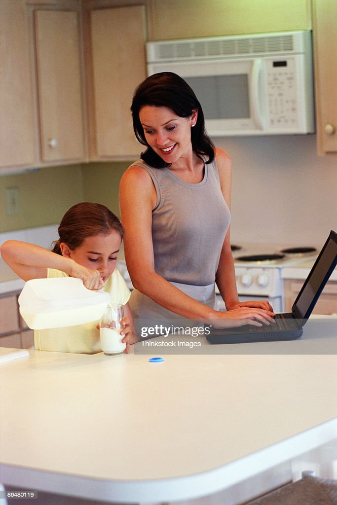 Mother and daughter in kitchen : Stock Photo