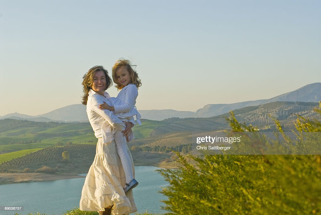 mother and daughter in nature : Stock Photo