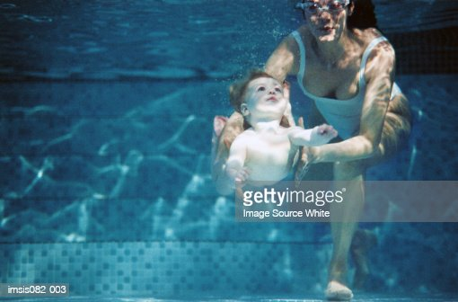 Mother and daughter in pool : Stock Photo