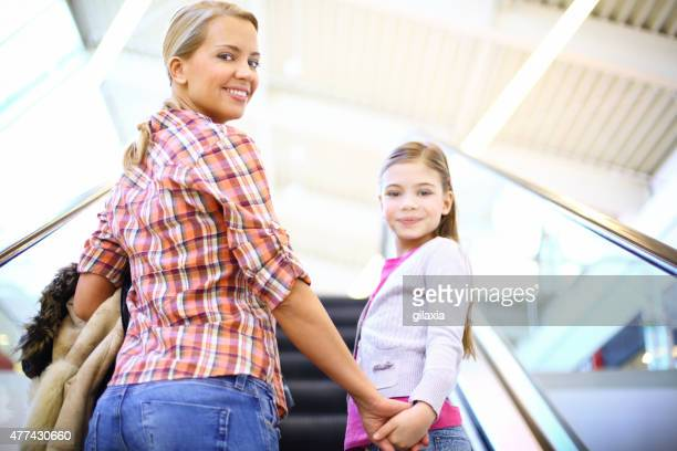Mother and daughter in shopping mall.